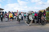 HASTINGS, ENGLAND - MARCH 23, 2014: Runners dressed in Rhino costumes take part in the annual Hastin