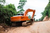 pic of earth-mover  - Heavy earth mover at construction site home - JPG