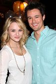 LOS ANGELES - MAR 25:  Hunter King, Matthew Atkinson at the Young and Restless 41st Anniversary Cake