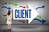 The word client and rear view of businesswoman against arrows pointing