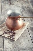 Roasted Coffee Beans And Copper Coffee Pot