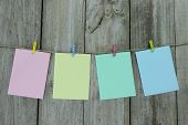 Pastel note cards hanging on clothesline