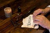 Man Rolls An  Old Parchment