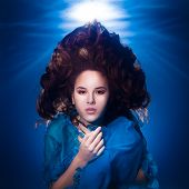 Underwater Photo Pretty Young Girl With Dark Long Hair Wearing Blue Fabric