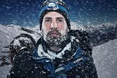 picture of perseverance  - Adventure mountain man in snow expedition with climbing gear and determination - JPG