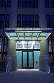 Modern Residential Building Entrance At Night
