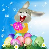 stock photo of duck egg blue  - Happy Rabbit with Easter Eggs on the green grass - JPG