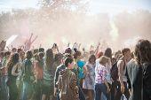 Tourist scelebrate festival Holi