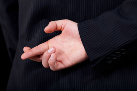 stock photo of nonverbal  - A closeup of a man doing a cheating gesture with his hand - JPG