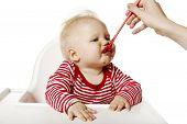 Feeding. Baby Eating Dinner