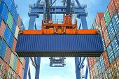 stock photo of trade  - Shore crane loading containers in freight ship - JPG