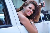 Attractive Woman Sitting In Car Showing Keys