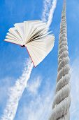 Flying Book And Rope Rises To Blue Sky