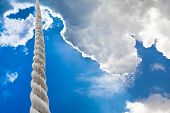 Towrope Rises To Clouds In Dark Sky