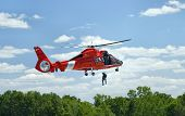 Picture of coast guard rescue chopper in action.