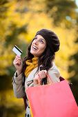 Woman With Shopping Bags And Credit Card In Autumn