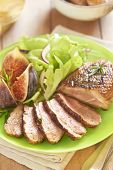 Roasted duck breast with figs and salad