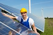 Photovoltaic Engineer Or Installer Installing Solar Panel