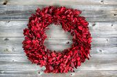 Natural Leaf Wreath For The Seasonal Holidays On Rustic Wood