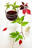 Autumn Still Life: Glass Of Red Wine And Grape Leaves