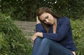 Sad Thoughtful Woman Sitting On Stairs