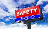 Safety Inscription on Red Billboard.