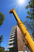 Heavy Hydraulic Crane On Blue Sky