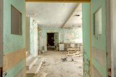 stock photo of dingy  - Interior of an abandoned building with rubble and debris - JPG