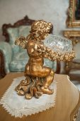 Постер, плакат: Golden ornament Angel with lyre ornament Vintage angel Metallic angel Cupid statuette