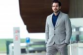 Attractive Young Businessman Outside In Airport