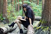 Girl Reading A Book In The Green Forest