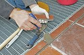 Worker Repairing And Grouting Patio