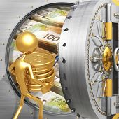 Putting Gold Coins In A Bank Vault