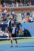 US Open 2014 men doubles champions Bob and Mike Bryan celebrate final match victory