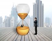 Man Oversee Businessman Flooded In Hourglass
