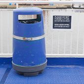 Blue Bin On Deck Of Cruise Liner