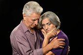 Sad elderly couple