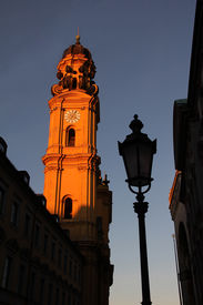 foto of munich residence  - illuminated theatiner church in the old town of munich in the evening sun - JPG