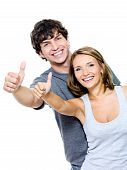 picture of thumbs-up  - Two young smiling people with thumbs - JPG