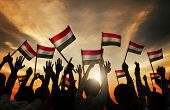 picture of iraq  - Silhouettes of People Waving the Flag of Iraq - JPG