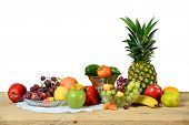 Assortment of fresh fruits and vegetables on wooden table indoors