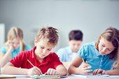 Portrait of two diligent classmates at lesson