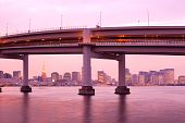 stock photo of kanto  - Access to Rainbow Bridge and city skyline with Tokyo Tower Odaiba Tokyo Kanto Region Honshu Japan - JPG