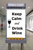 Keep calm and drink wine sign inside shopping mall