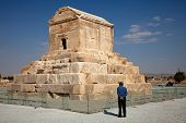 A Man Standing Beside Cyrus Tomb In Pasargad Of Iran