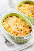 Casserole with pasta and cheese with herbs