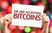 We Are Accepting Bitcoins card with colorful background with defocused lights