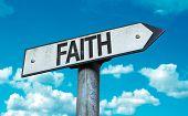 Faith sign with sky background