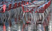 Reflection On The Water Table And Chairs In Venice During The Flood