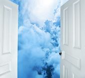 White doors opening to dreams and success
